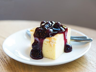 Skinny cheesecake with berries on a white plate