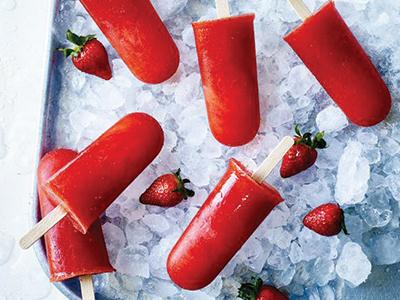 Strawberry sangria ice pops in bucket of ice