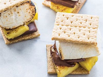 Pineapple coconut s'mores with Mounds candy bar marshmallow and graham cracker crust