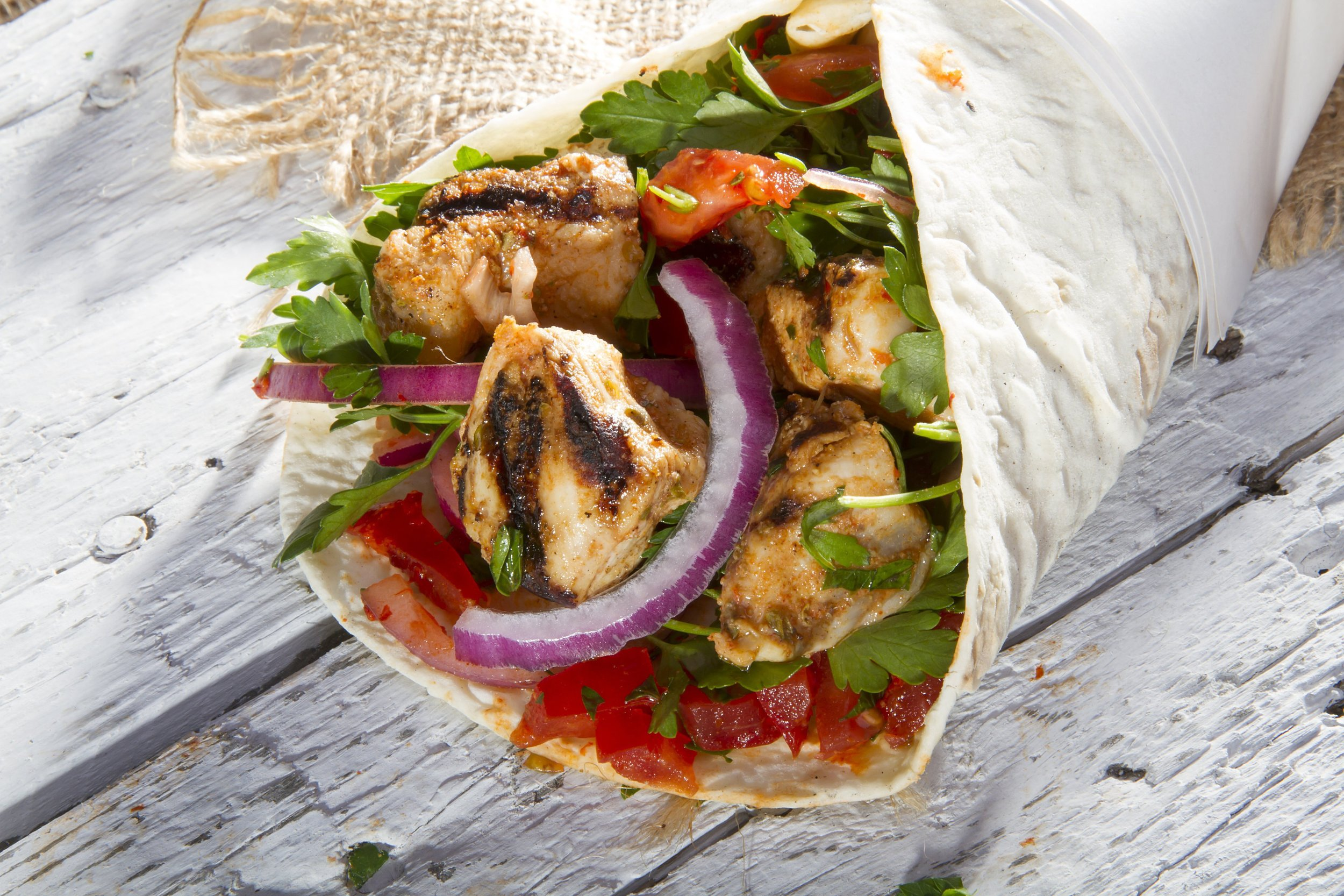 Chicken fajita wrap with onions and peppers