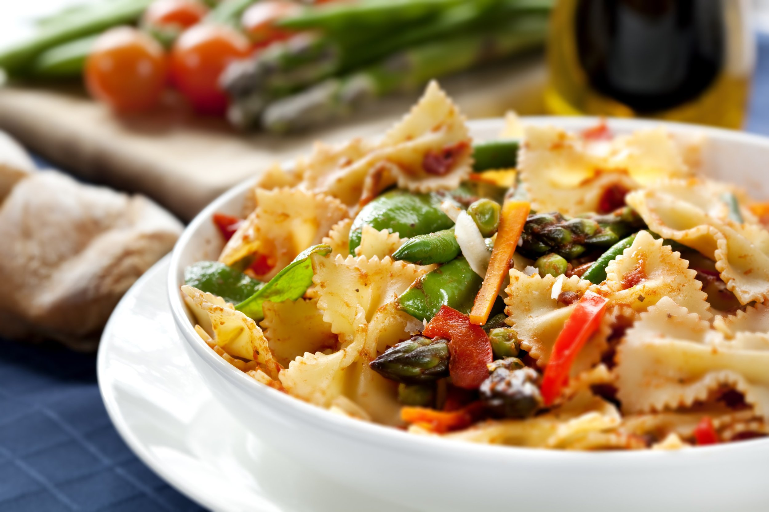 Spicy farfalle pasta with chicken garlic onions tomatoes jalapenos and asparagus