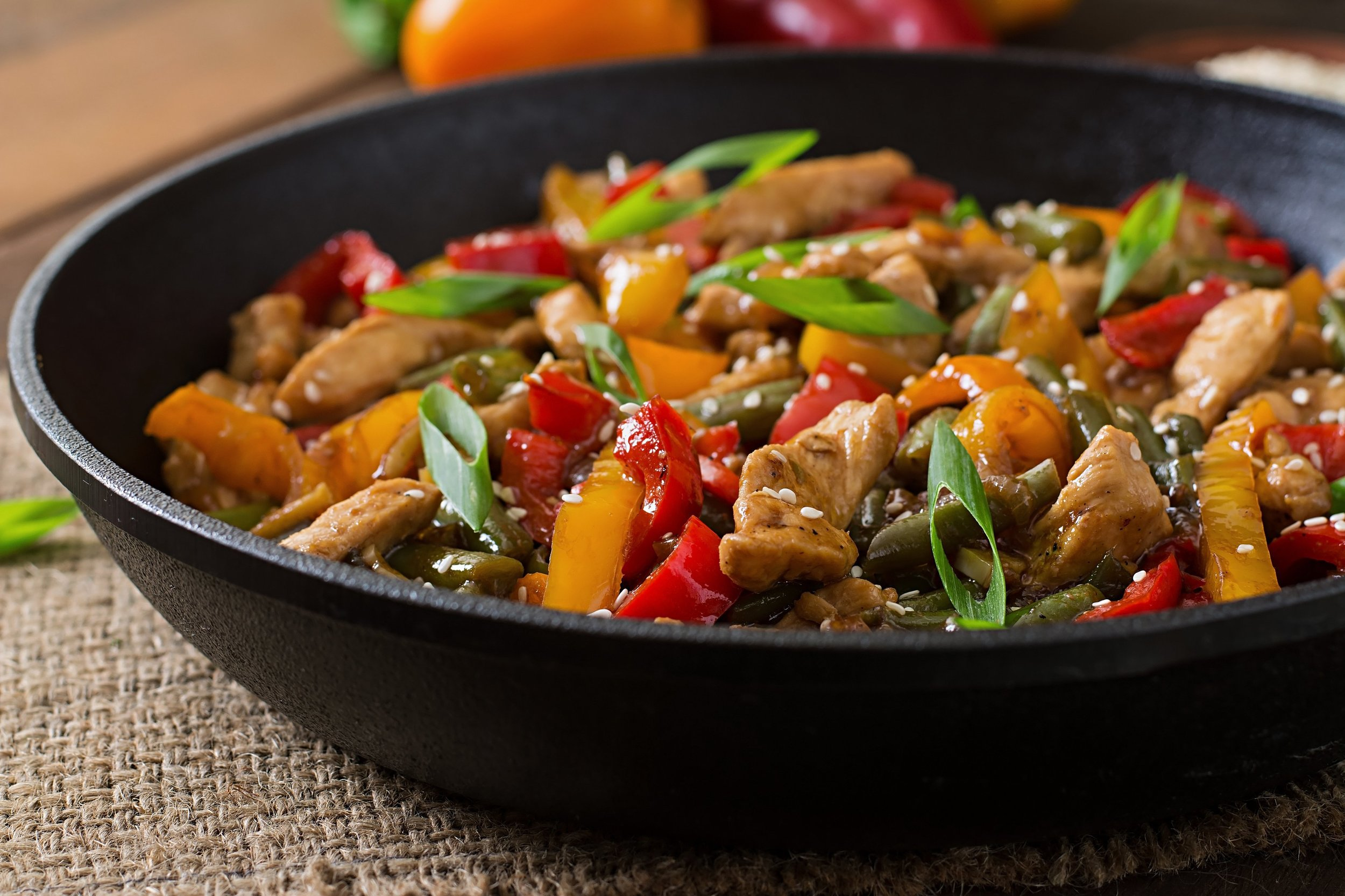 Chicken stir fry with bell peppers onions soy sauce garlic and rice