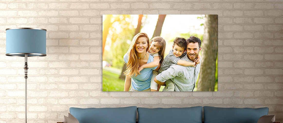 Simple Canvas photo of family hanging on wall above blue couch