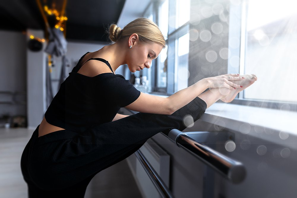 Woman-at-barre-workout-stretching.jpg