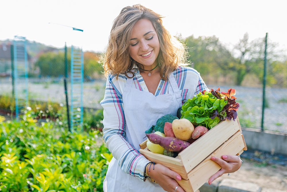 woman-holding-box-of-vegetables.jpg