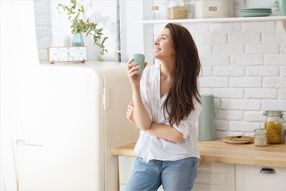 woman-smiling-with-drink.jpg