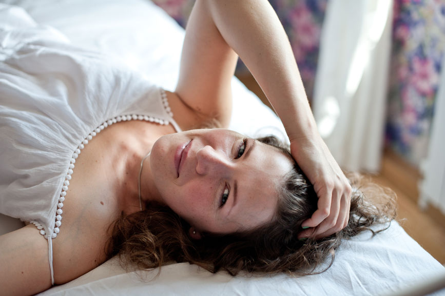 young woman laying on bed.jpg
