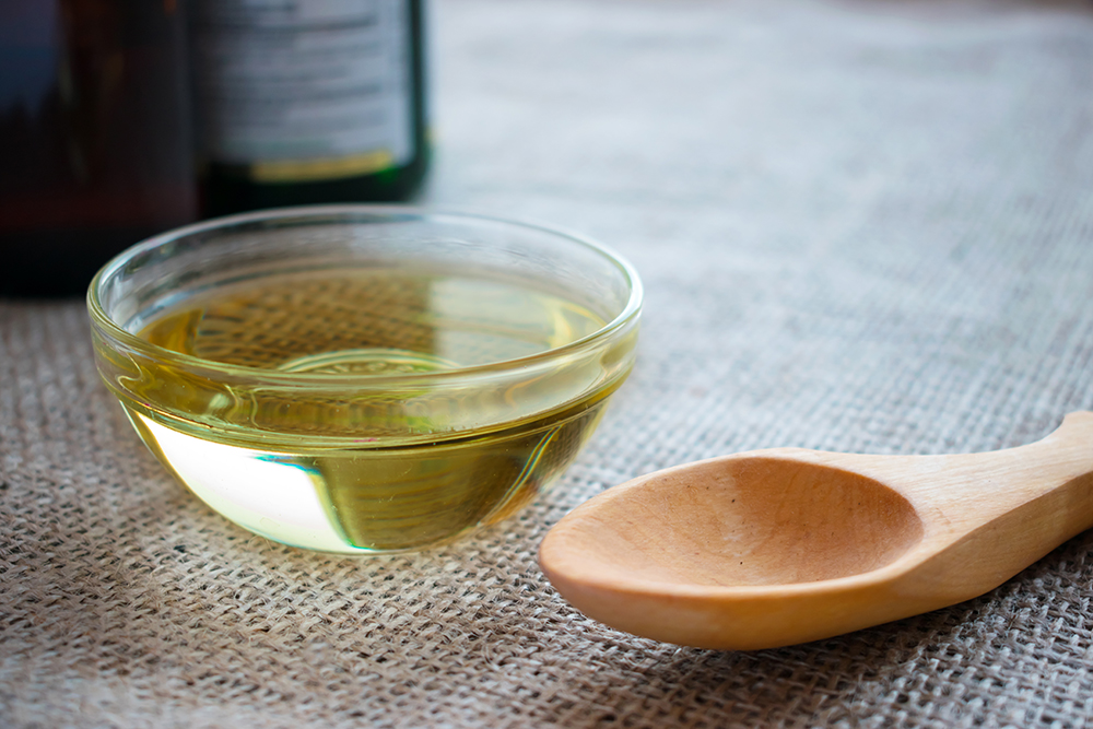 MCT Oil with wooden spoon.jpg