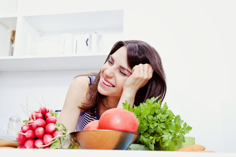 Happy woman with fresh produce