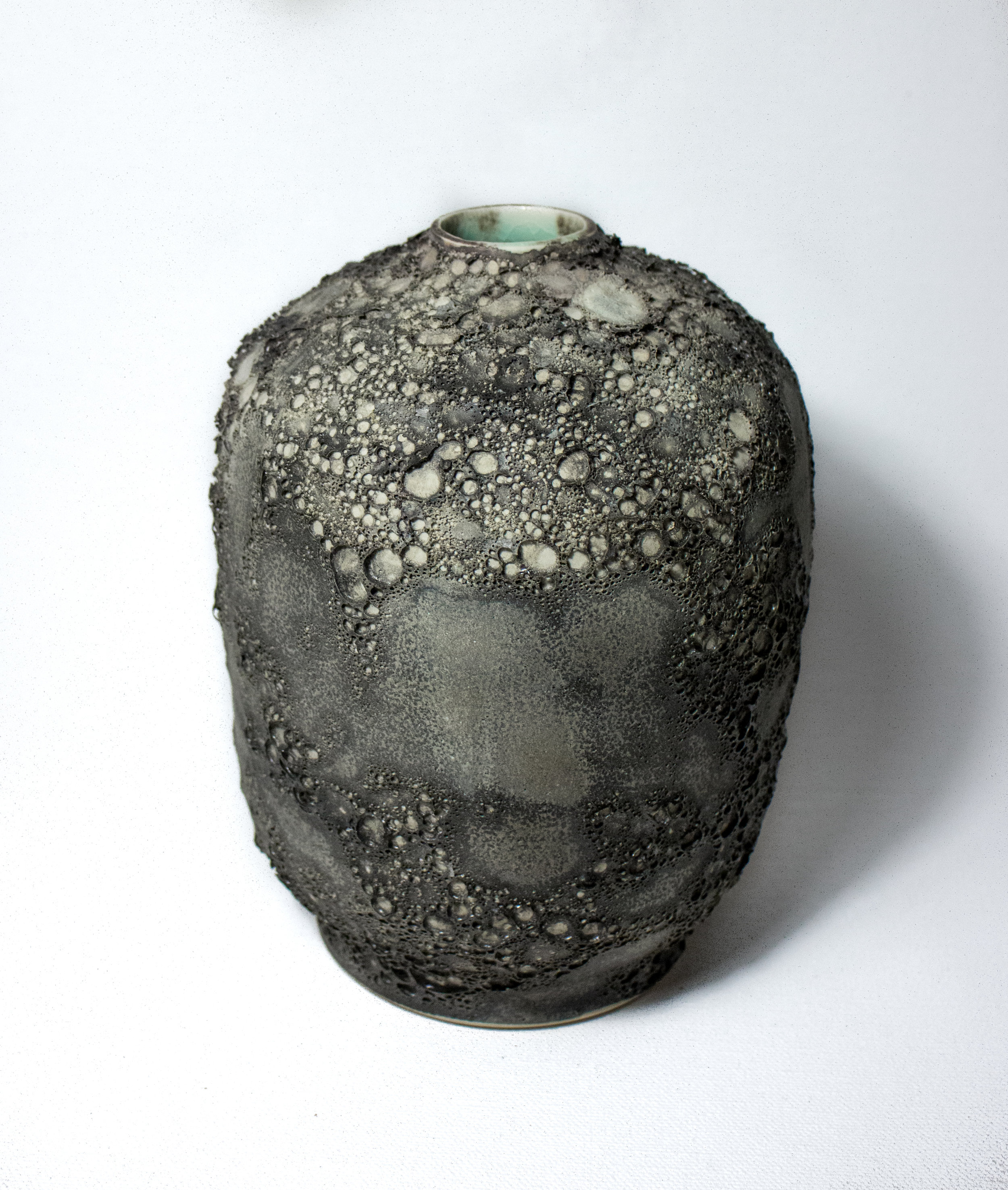 Porcelain Vessel in mars Lava Exterior Glaze Frozen Aqua Interior