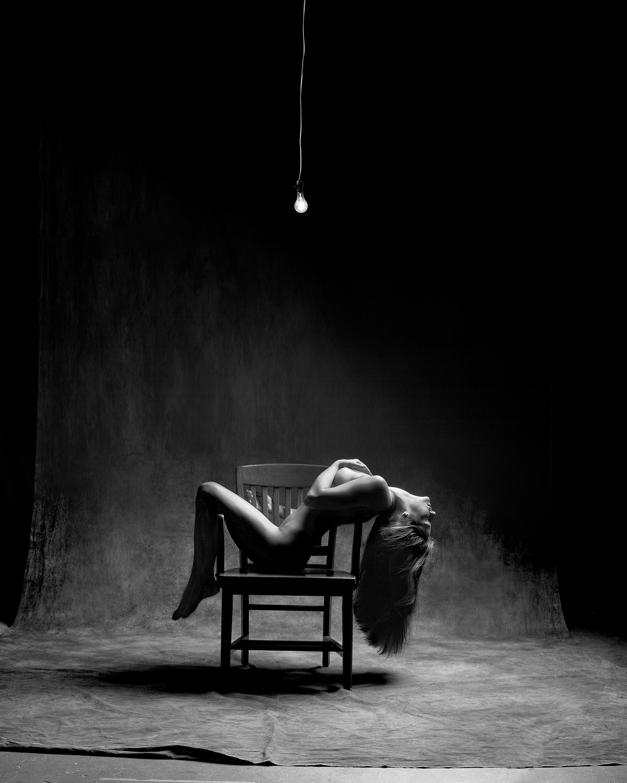 Woman With 60 Watt Bulb