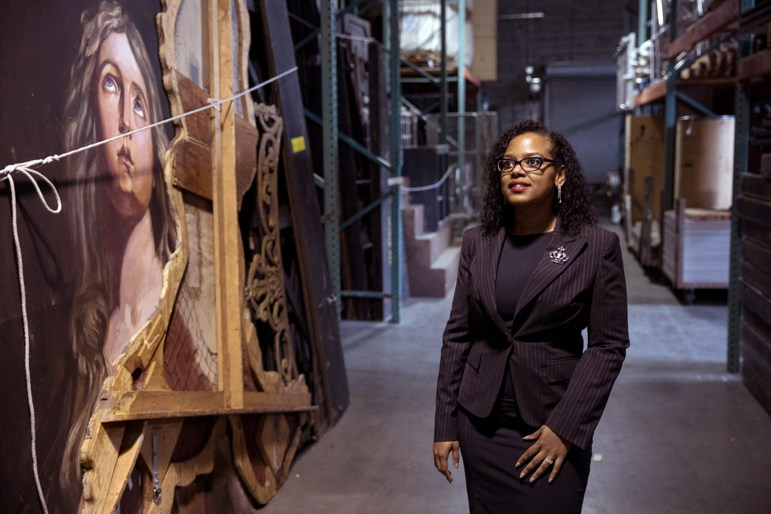 Photo Description: ChrisTiana ObeySumner standing in front of a piece of artwork. Photo credit:  Matt M.McKnight/Crosscut