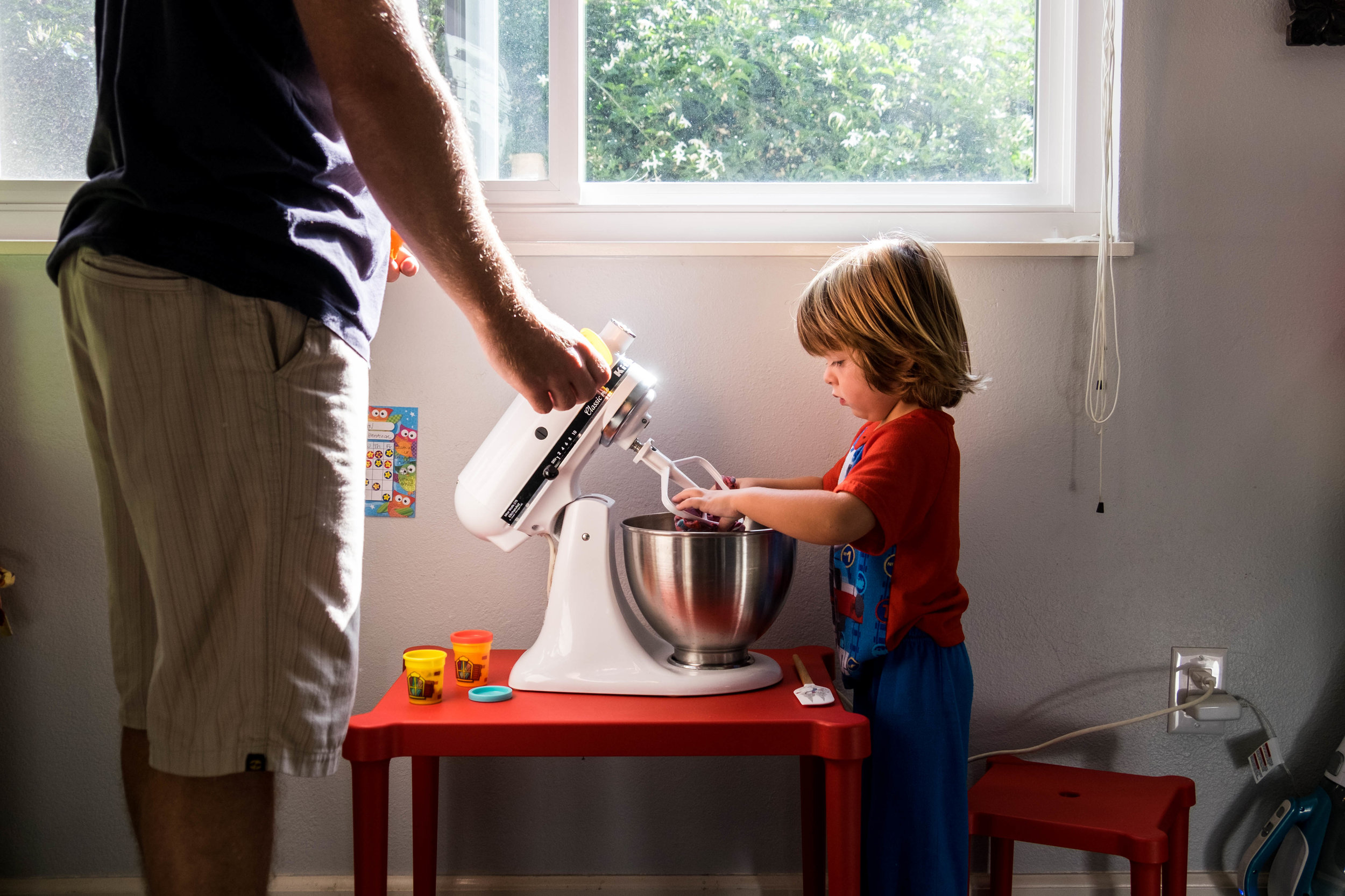 it's baking time; daddy helps dylan