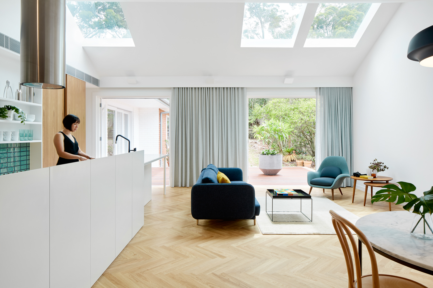 Looking at kitchen to outside with skylights above