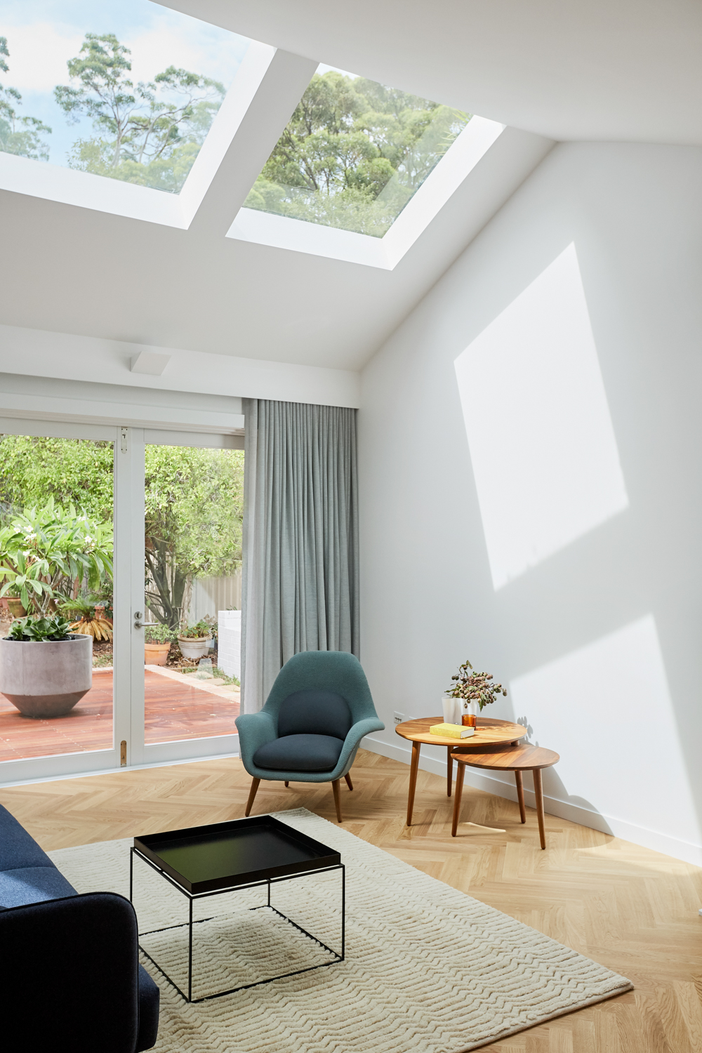 Looking at living room to outside with skylights above