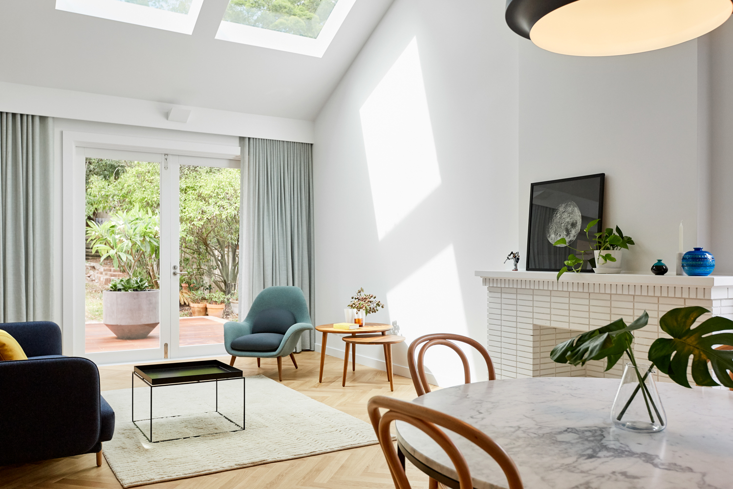 Living room with skylights above