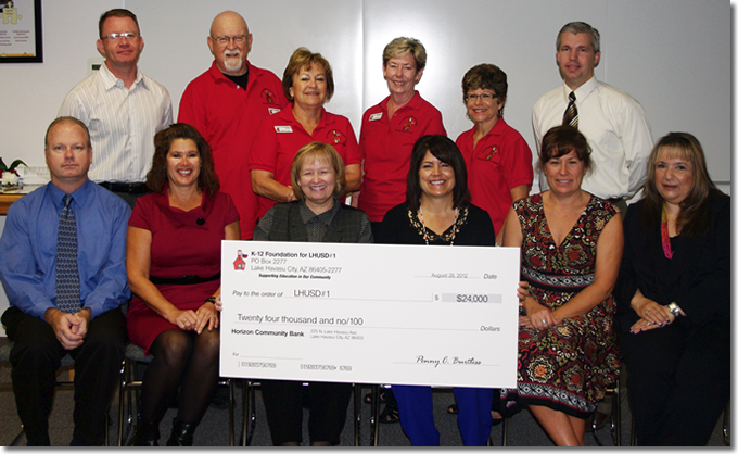 In 2012, the K-12 Foundation presented a total of $24,000 ($3,000 to each school) with the assistance of our major donors . Pictured above are K-12 board members, Lake Havasu School District principals and Superintendent Gail Malay during a district school board meeting. You too, can join us in our efforts by becoming a member online here.