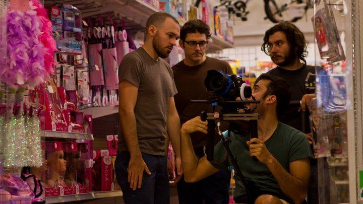 Dustin Shroff (director) and Robert Gomes (producer) consult with Ricardo Diaz (cinematographer) and Billy MacCartney (assistant camera) on the set of  Deflated.
