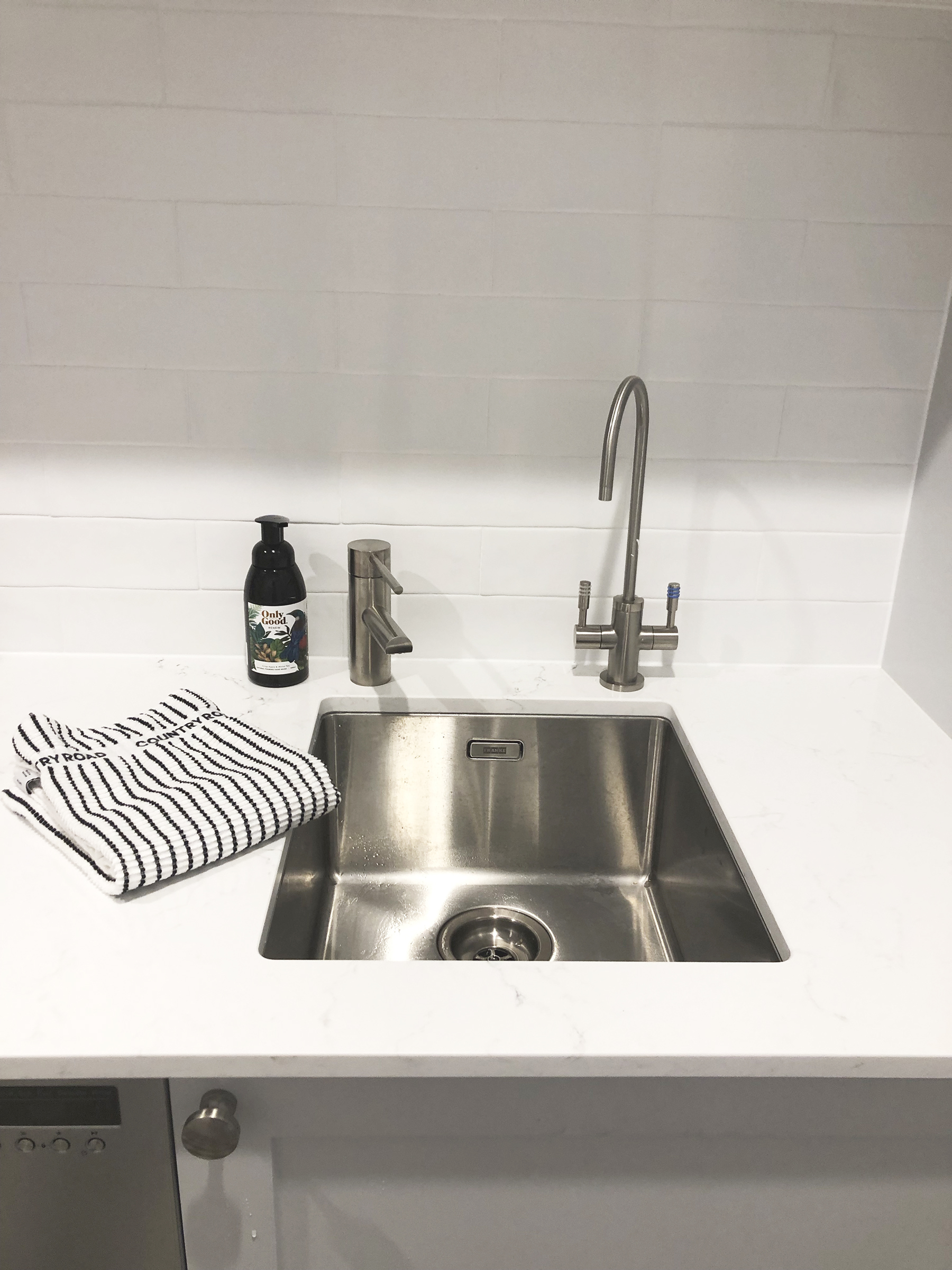 We chose to integrate our water tap into the butlers' pantry benchtop, to keep the kitchen benchtop clutter-free.