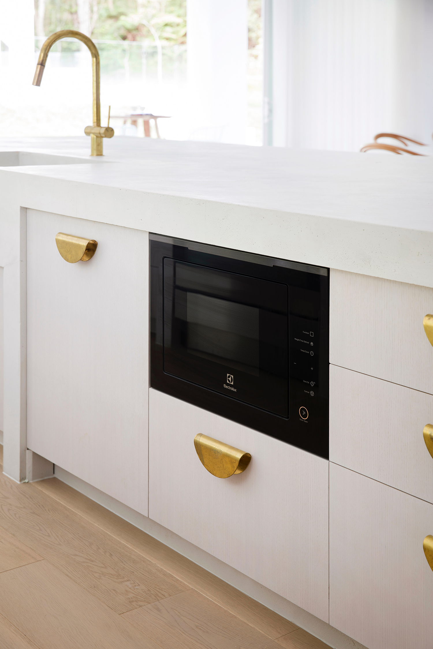 That's the Electrolux integrated dishwasher hidden to the left of the built-in microwave.