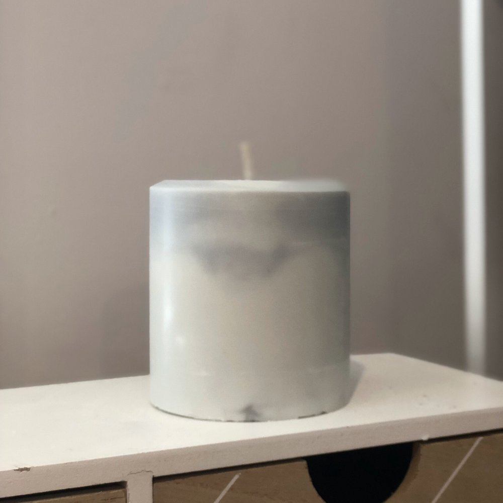 Pillar candle with marble effect