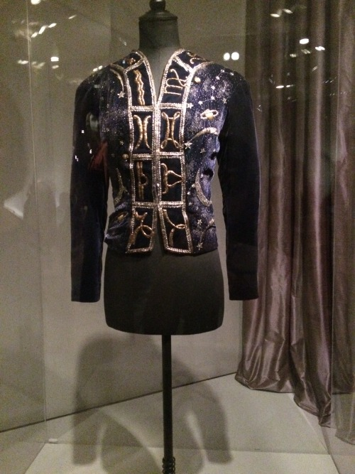 Seen above is a blue velvet 'celestial' evening jacket by Elsa Schiaparelli from circa 1920 finished with a combination of matte and sheen to resemble 'stardust'; twelve zodiac signs embroidered using gold thread and rhinestones to represent comets and shooting stars. Even in today's fashion, iconography is often used to express a designer's personal interest. An example is Jeremy Scott's usage of cartoon characters in his designs to express his playfulness.