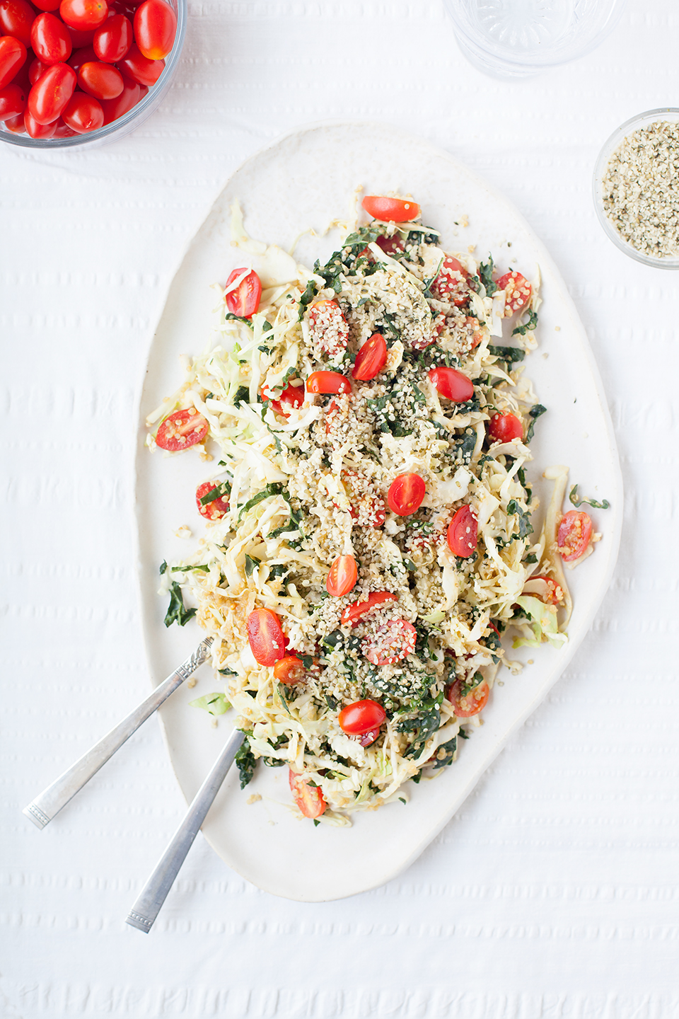Kale + Cabbage Salad with Creamy Nutritional Yeast Dressing | Vegan, gluten-free, and paleo. | A healthy kale and cabbage salad with creamy nutritional yeast dressing topped with cherry tomatoes and hemp hearts. Vegan, gluten-free, and paleo. LOVELEAF CO. #healthy #salad #kale #slaw #coleslaw #nutritionalyeast #healthysaladdressing #dressing #dairyfree