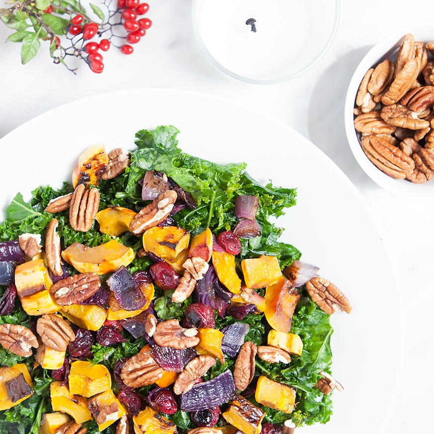 DELICATA SQUASH AND CRANBERRY KALE SALAD - If you've been looking for lighter Thanksgiving sides, look no further. This salad is the perfect holiday dish because it's healthy, bursting with flavor, make-ahead friendly, and – the best part – super easy to make; roast everything on one pan and you're good to go.