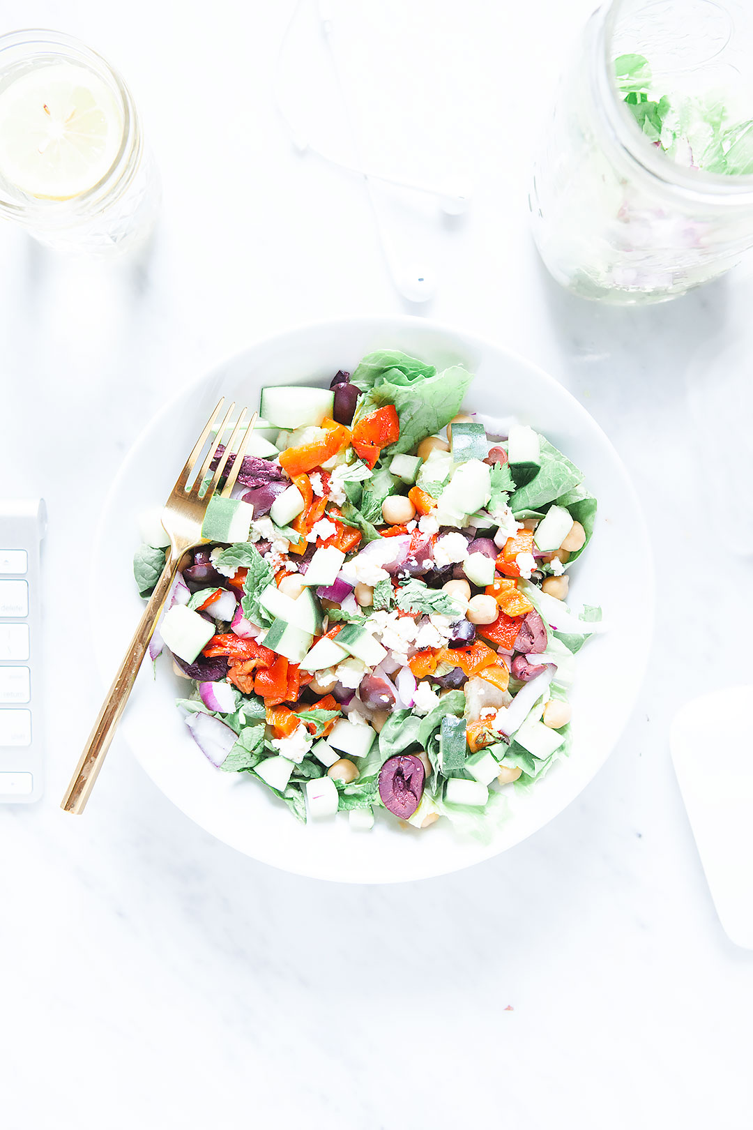 CHOPPED GREEK POWER SALAD | A refreshing, healthy chopped Greek salad with a simple red wine vinaigrette. Full of Greek flavor with oregano, roasted red pepper, mint, and feta. Easy to meal prep or pack to bring to the beach! | LOVELEAF CO. #greeksalad #mealprep #easyrecipe #salad #greek #masonjarsalad #mealprepsalad #easysalad #lunchideas #saladdressing #lunchideas #lunchmealprep