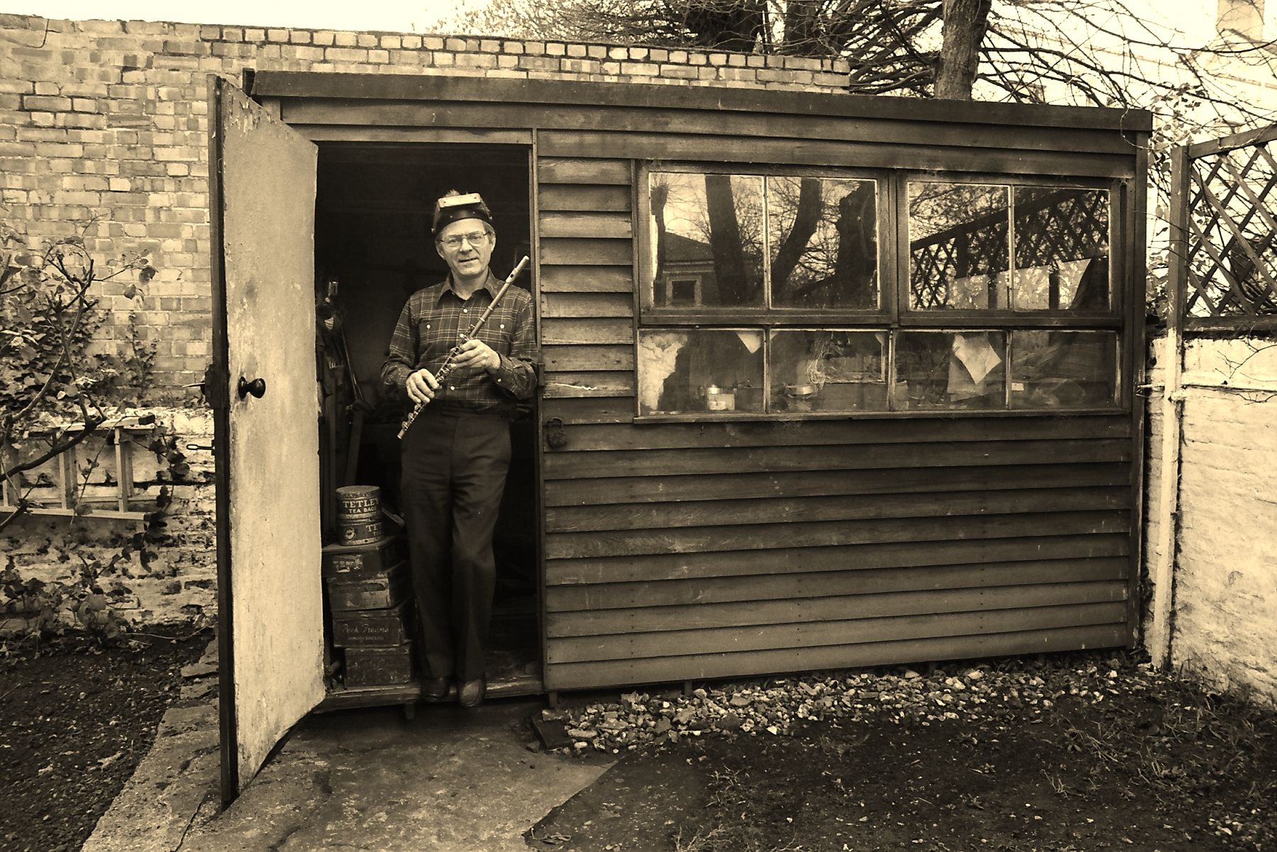 Albert Cooper in front of his  flutemaking shed  London, England c. 1980