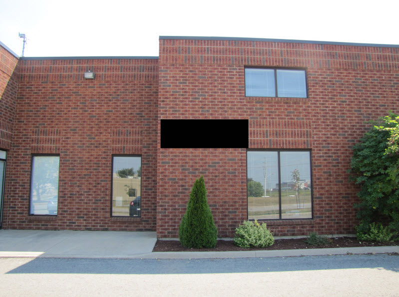 Industrial building for lease in St. Catharines - 330 Vansickle Road #2 which features small front showroom and an open warehouse with grade level door access at the back.