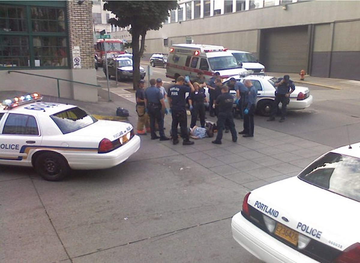 MAN DOWN: On Sept. 17, 2006, police, firefighters and paramedics surround an injured James Chasse in a Pearl District crosswalk. ( Williamette Week )