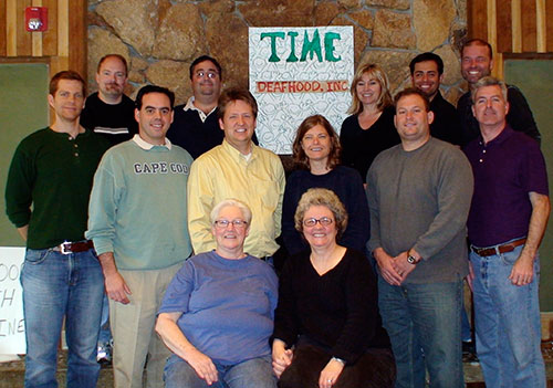 The first gathering to create the Foundation at Asilomar Conference Center, Pacific Grove, California in February 2007.  (Deafhood Foundation Website - About Us)   Front: (l to r): Judy Gough and Ella Mae Lentz Middle row (l to r): Colin Piotrowski, Danny Lacey, Marvin Miller, Kathy Say, Clark Brooke, Joey Baer Back Row (l to r): Kevin Clark, Don Grushkin, Nancy Mitchell, David Eberwein, Butch Zein
