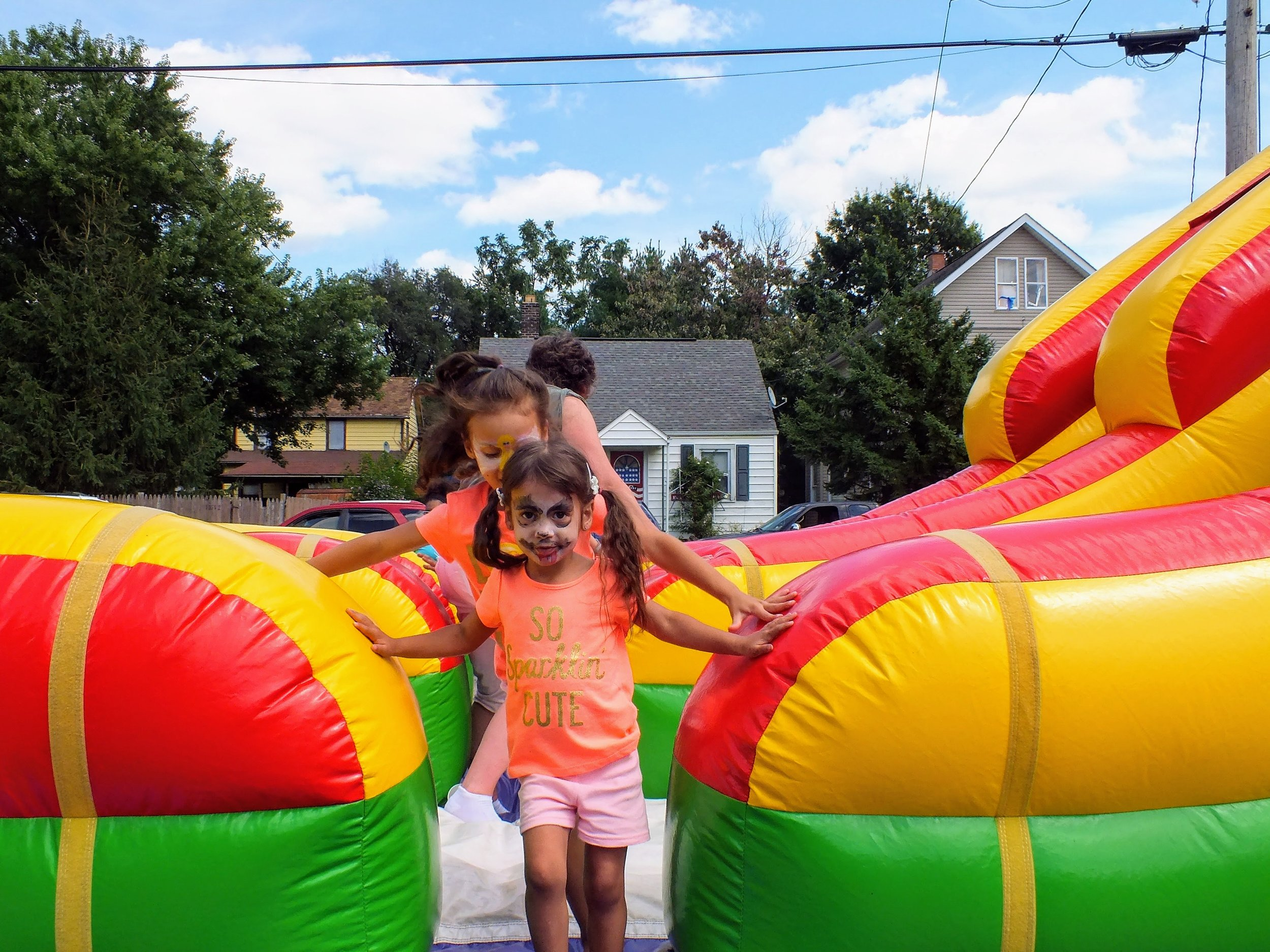 Children's festival - Every year our parish connects with the children of our neighborhood by hosting a festival. There is music, popcorn, face-painting, small rides, and, of course, the renowned