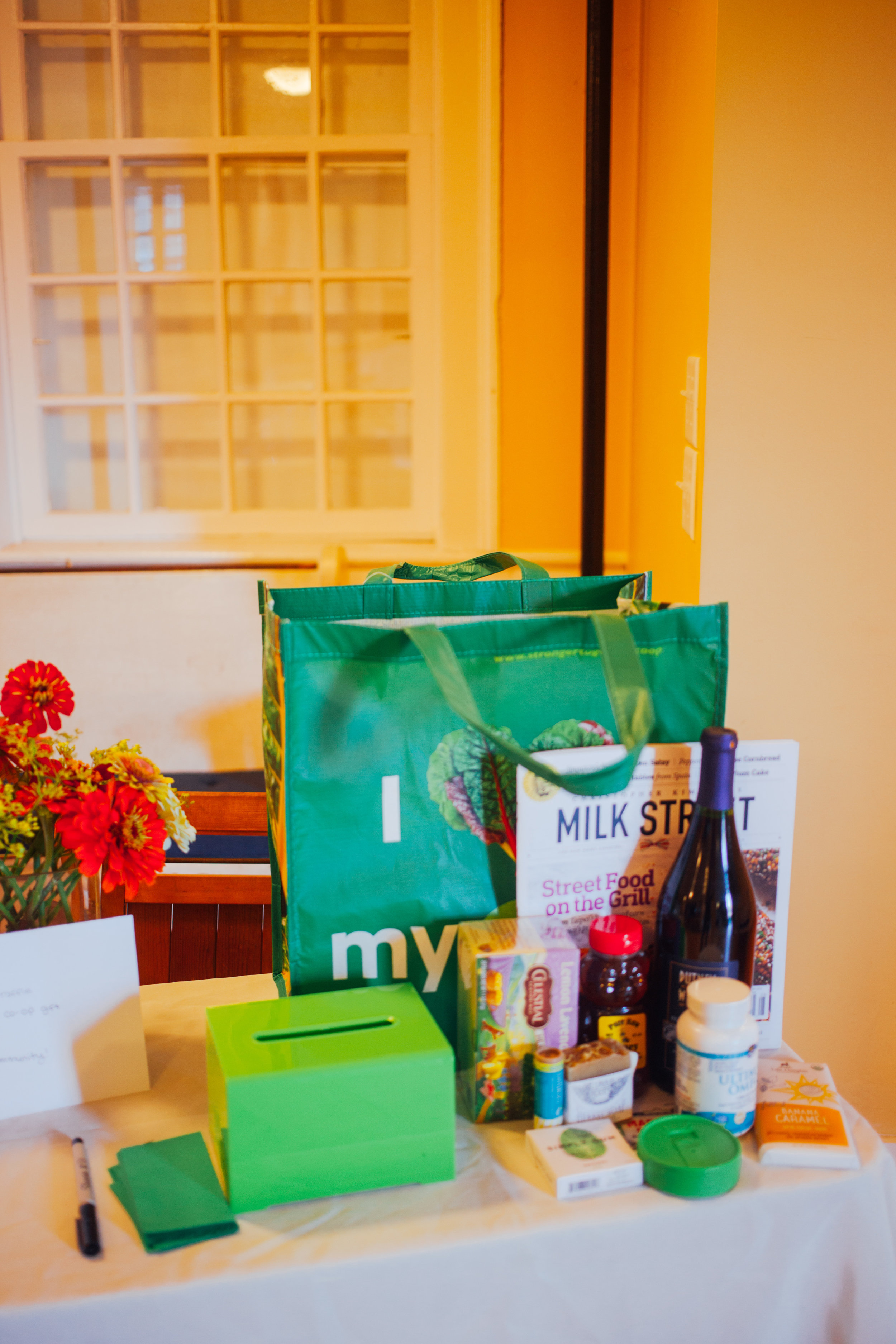 Community member and owner of Antidote Books Ruth Rodriguez won our special Putney Co-op raffle for attendees of the party!