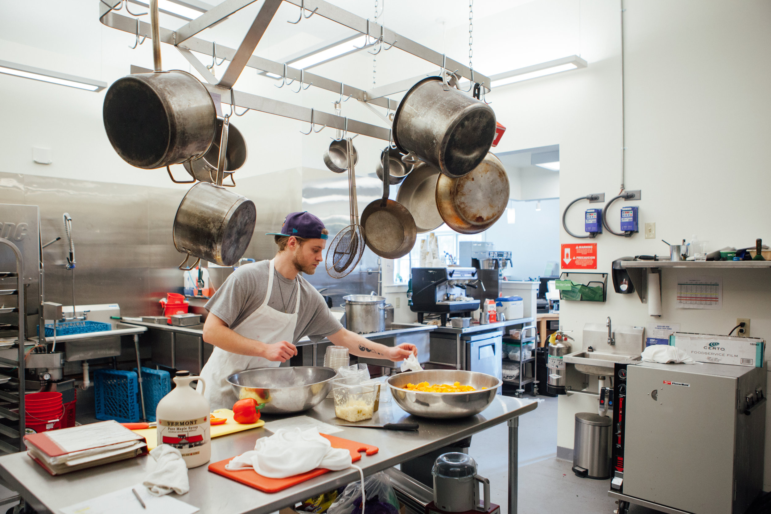 Our talented cook Jason prepares a salad in our much bigger and better new kitchen space!