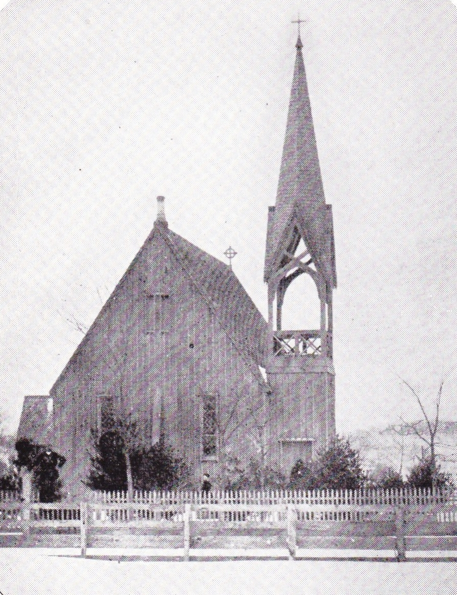 This early photograph of the Church of the Regeneration cannot now be dated with precision, but it certainly was taken some time after 1861, when the fence in the foreground was erected, and before 1879 when Theron Wilber, who has been identified as the individual standing with his hand on one of the fence posts, died. Since the young trees about the church seem well developed, it is probable that the photo was taken in the late 1860s or early 1870s. Note that the main entrance to the church then faced the west instead of the south, as at present, and that the belfry is vacant. It was this old photograph, owned by Mrs. E. Matthew Netter, from which the cover illustration derives.