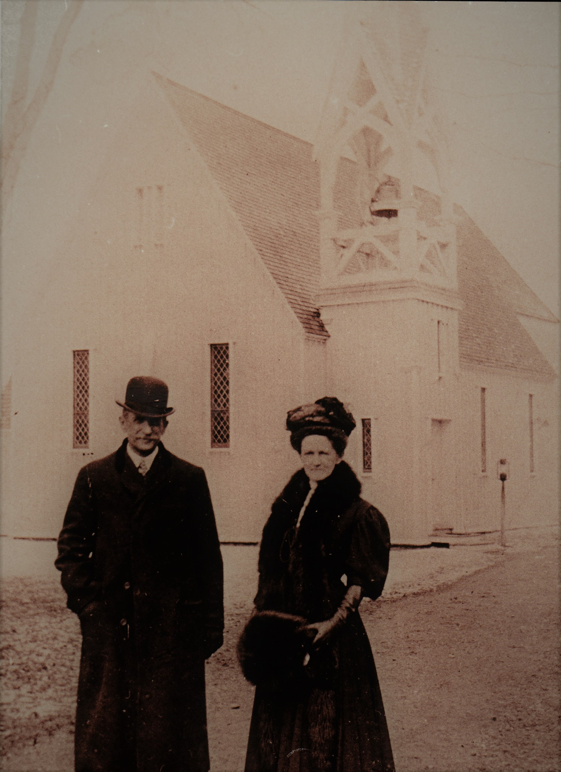 John and Grace Duxbury in front of the Church of Regeneration