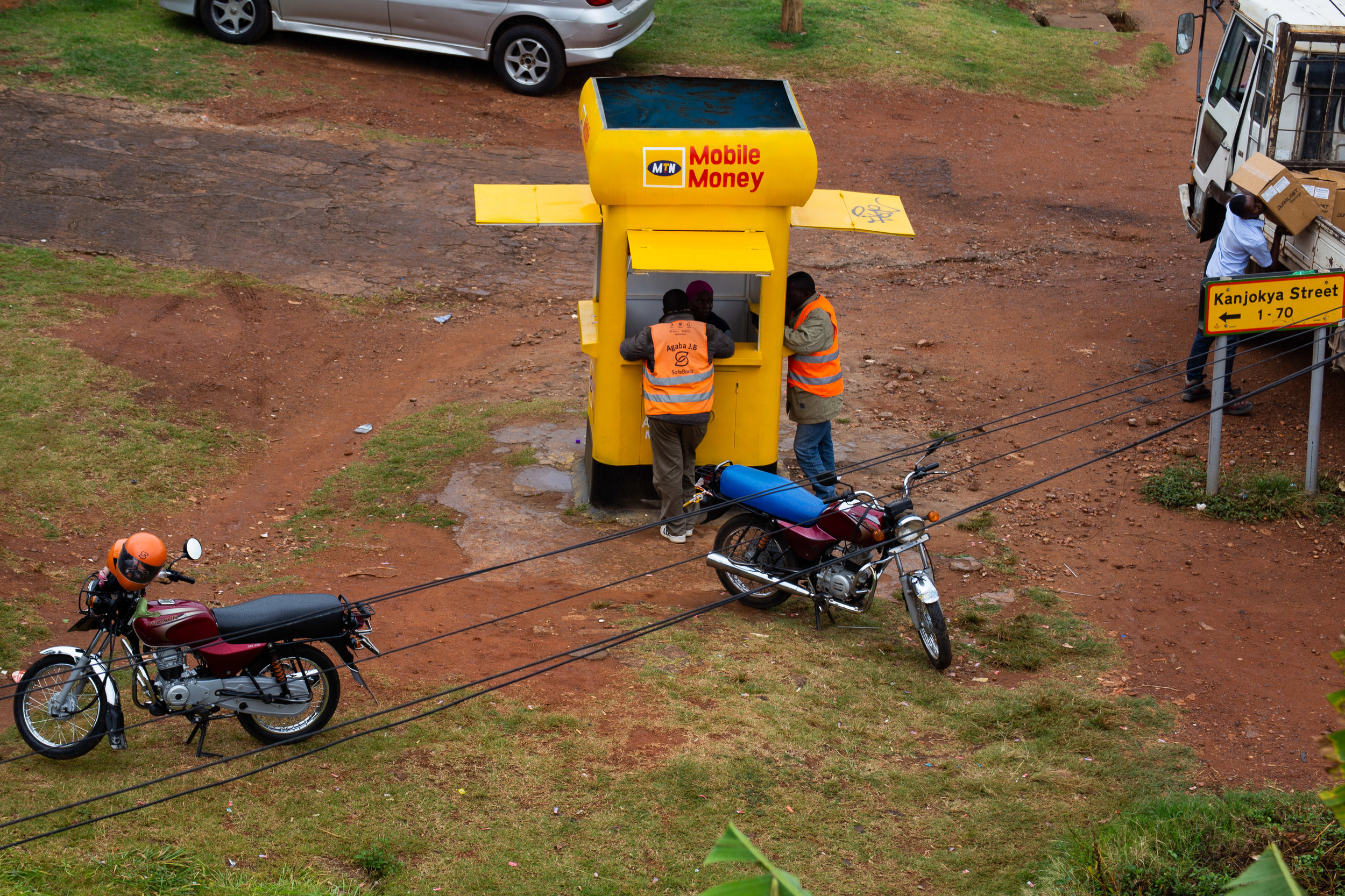 MTN Mobile Money station and SafeBoda riders by Kanjokya Street, Kisementi
