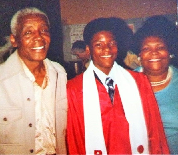 Junius Pierre (left) and Dorothy Robinson Cole (right), the parents of eight, four of whom attended the AEC; pictured here at the confirmation of their grandson, Damon Cole (center).