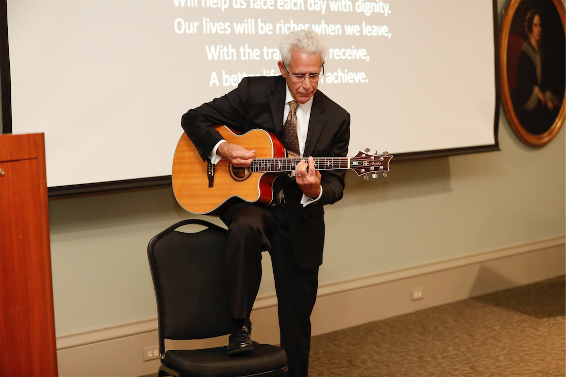 Stephen Geoffray plays the Adult Education Center school song, written by Alice Geoffray.