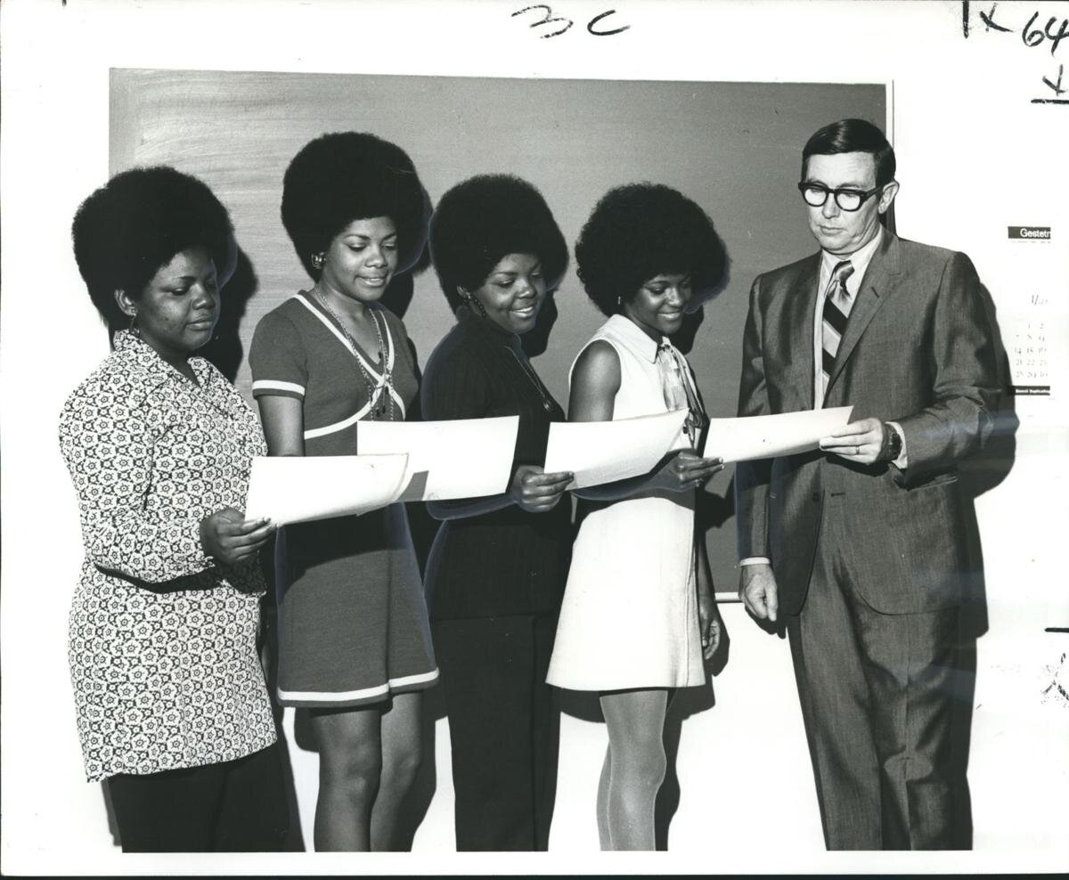 [From left] Brenda, Eunice, Carol and Pamela Cole, four sisters who were all graduates of the Adult Education Center, are recognized with letters of commendation by Charles Blackburn, Vice President of Shell Oil Co.  Photography by Leon Trice