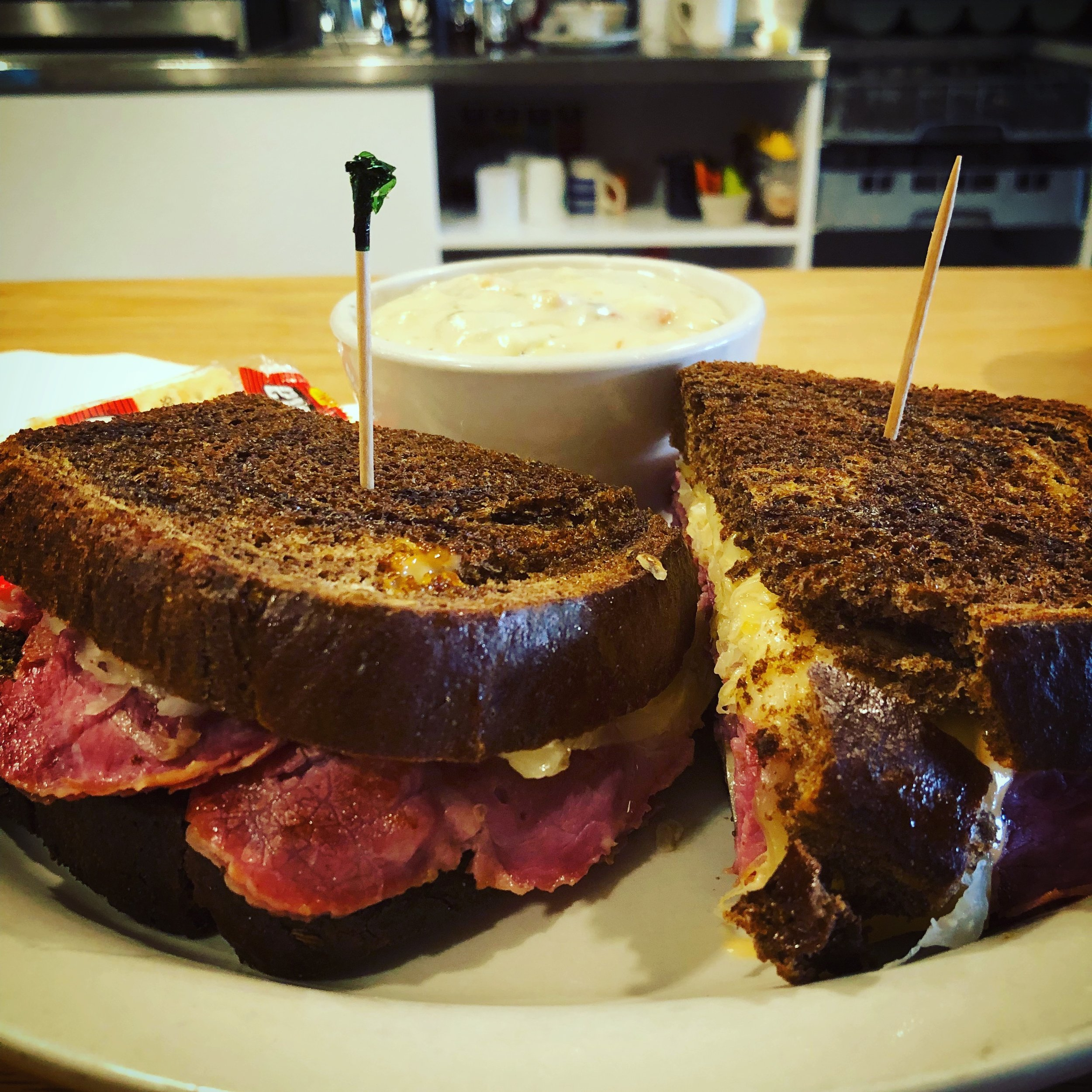 Reuben sandwich and a cup of clam chowder.