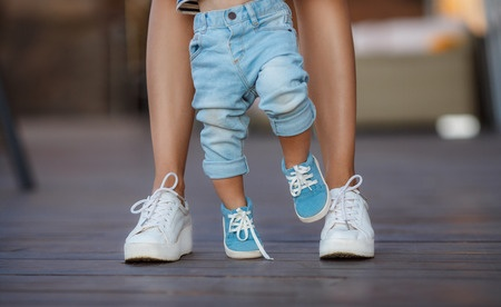 44560555_S_toddler_walking_shoes_mom_sneakers_steps_legs_grip_woman.jpg