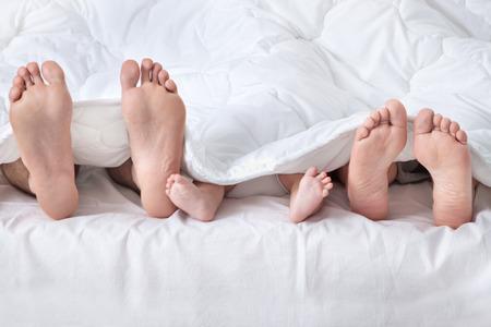 34580064_S_male_female_infant_toddler_feet_blanket_bed_laying_sleeping.jpg
