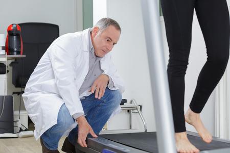 80369848_S_treadmill_gait_doctor_podiatrist_woman_walking_observing_feet.jpg