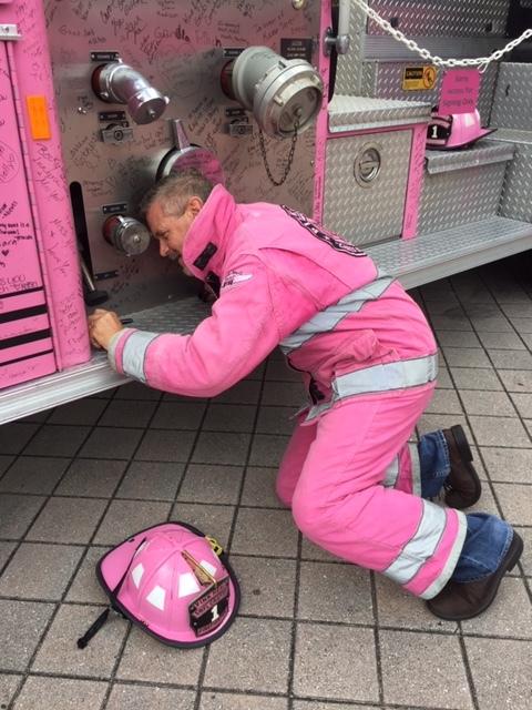 2 Time Prostate Cancer Survivor Chaplain Goodman signing Pink Heals fire truck