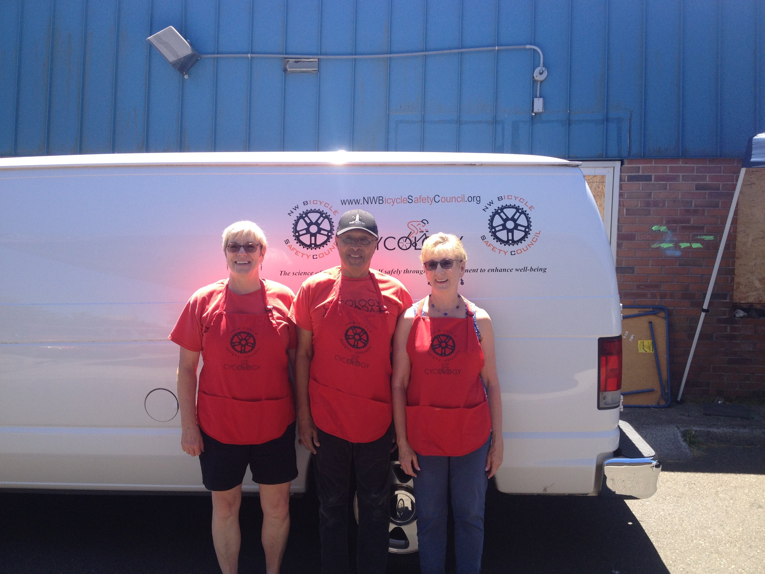 The NWBSC helmet-fitting team enjoying the sunshine at Rosewood Walkways