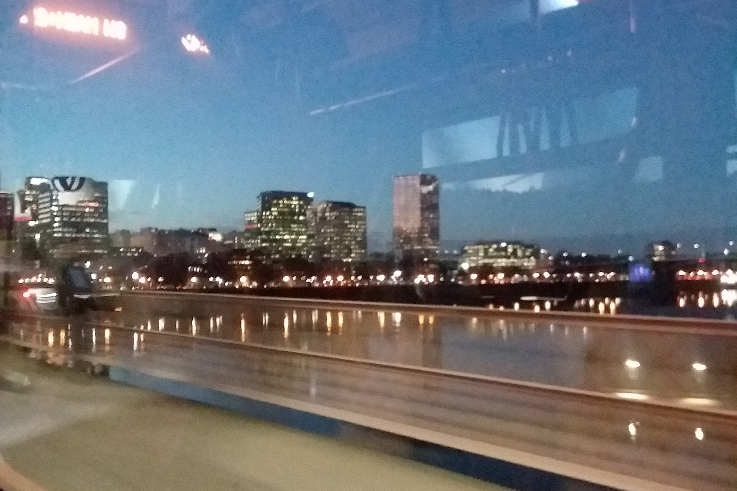 Image of downtown Portland at twilight, taken from a bus going across a bridge. Photo taken by the author of this post.