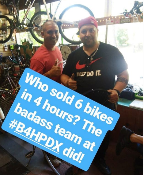 Picture of Tino standing next to childhood friend Frank. Text on picture reads: Who sold 6 bikes in 4 hours? The badass team at #B4HPDX did!
